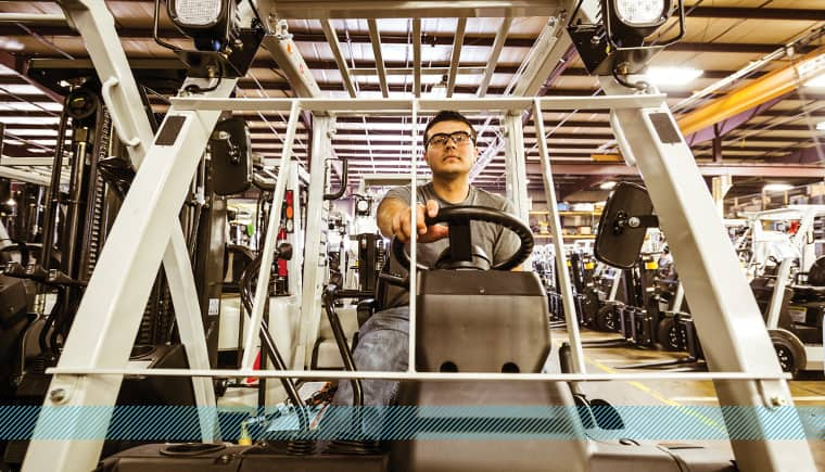 Forklift trainer driving a forklift